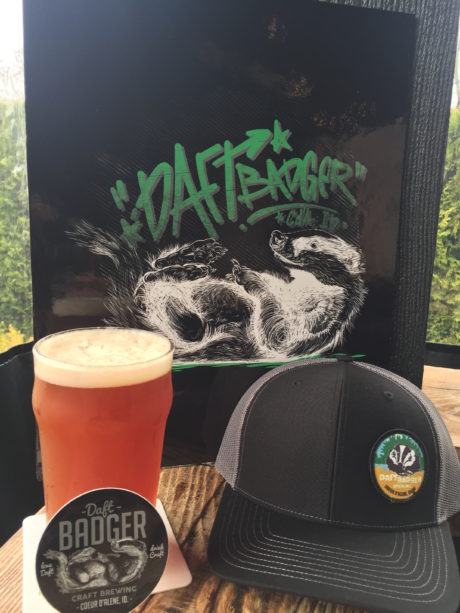 PINT GLASS WITH BEER, A HAT AND A BEER COASTER