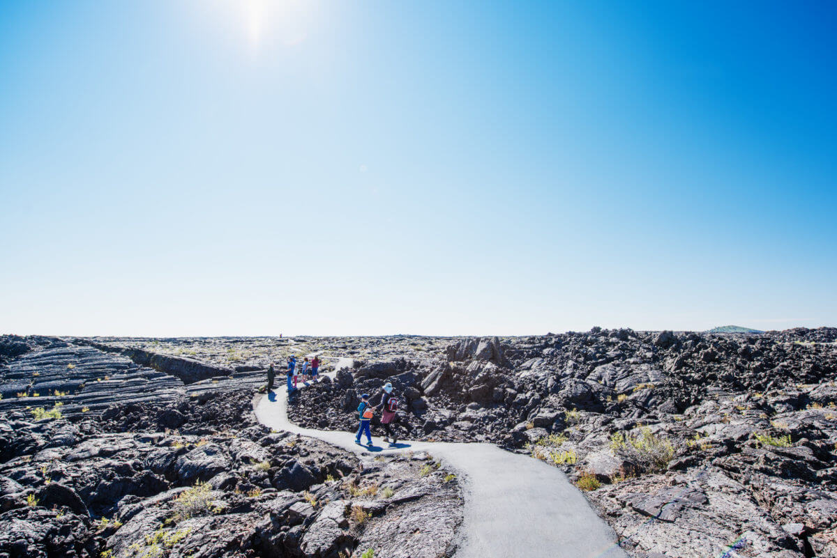 Hiking, Craters of the Moon National Monument and Preserve, Near Arco. Photo Credit: Idaho Tourism