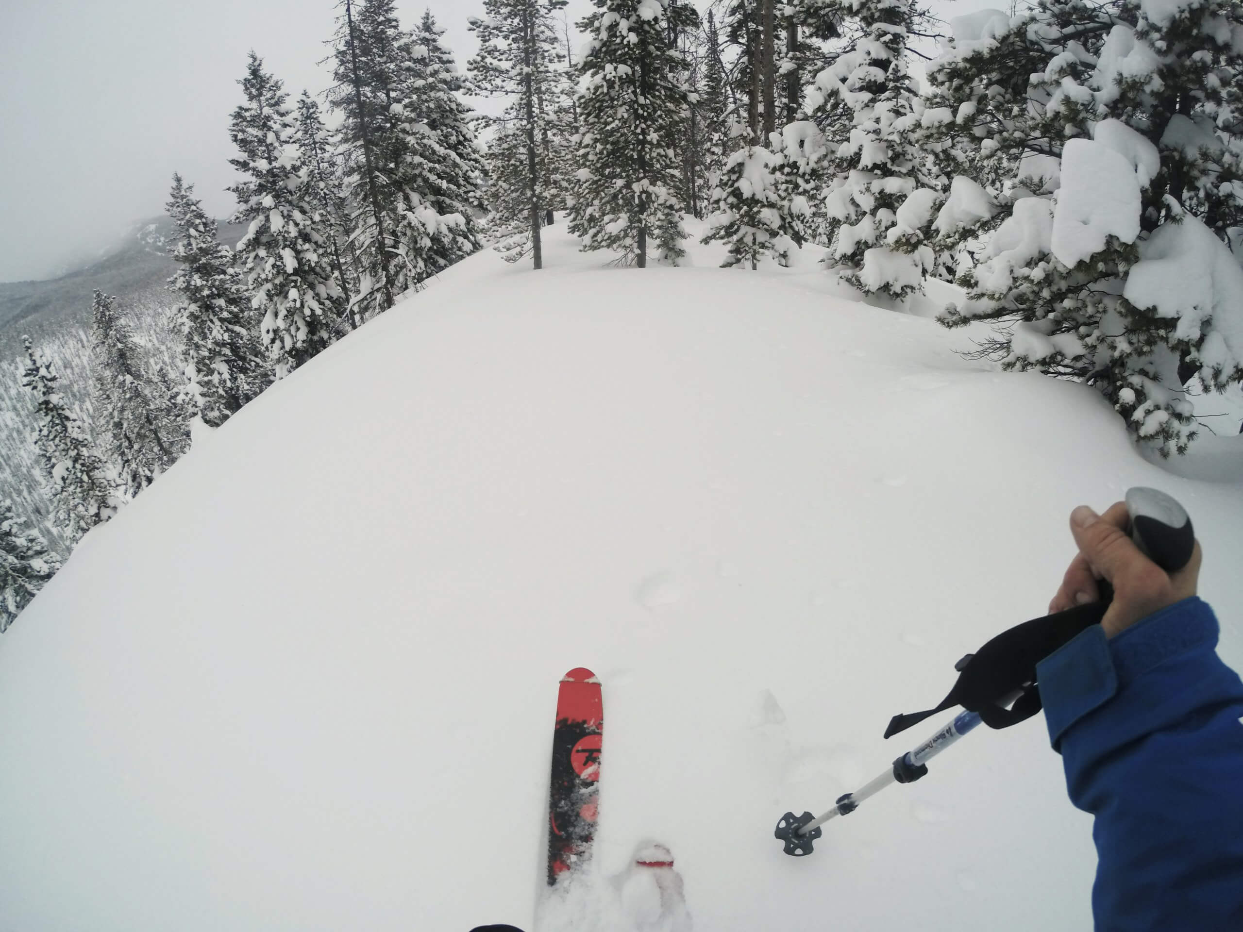 backcountry skier on top of mountain