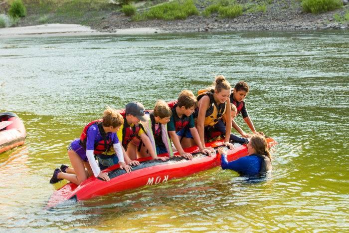Kids playing on an inflatable kayak
