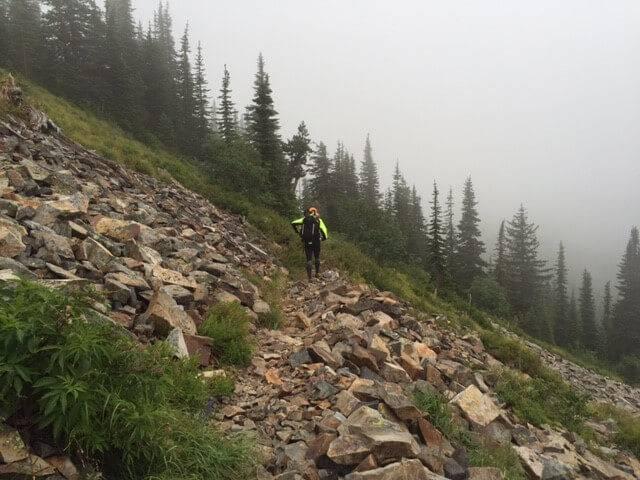 runner on rocky mountain trail