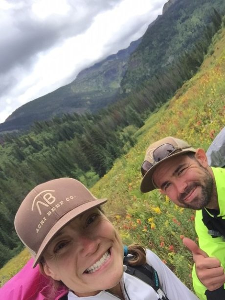 TWO HIKERS IN A MEADOW