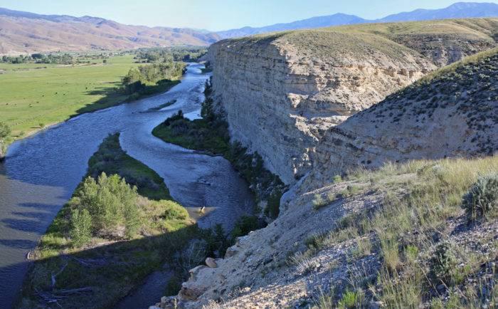 river running along cliffs