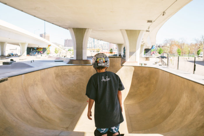 skater getting ready to drop into a bowl in skate park