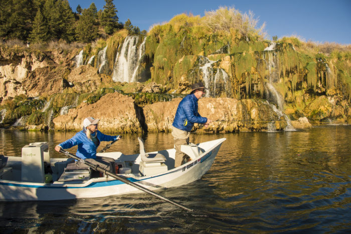 two people fishing in a drift boat