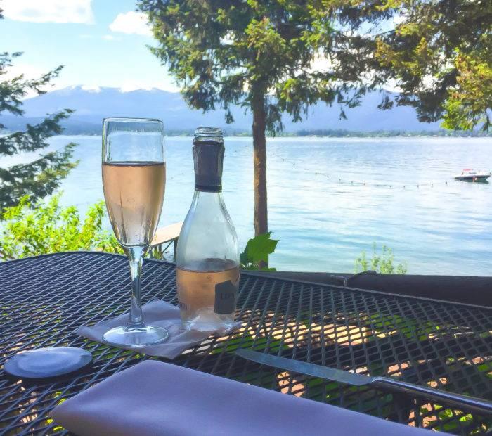 champagne glass next to lake