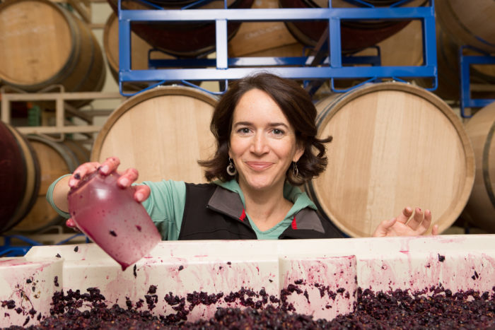 woman next to fermenting grapes