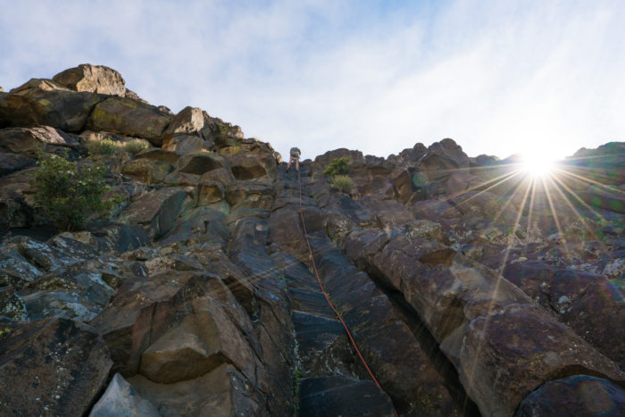 Climber on rocky cliff