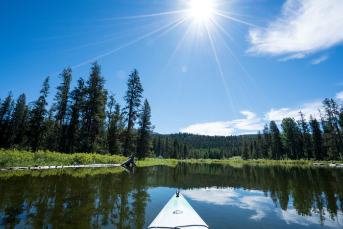 tip of a kayak in a lake