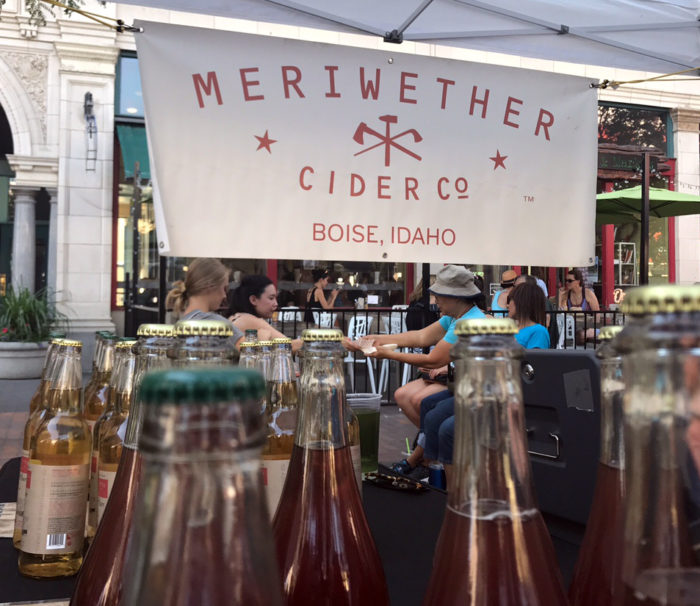 bottles of cider at outdoor stand