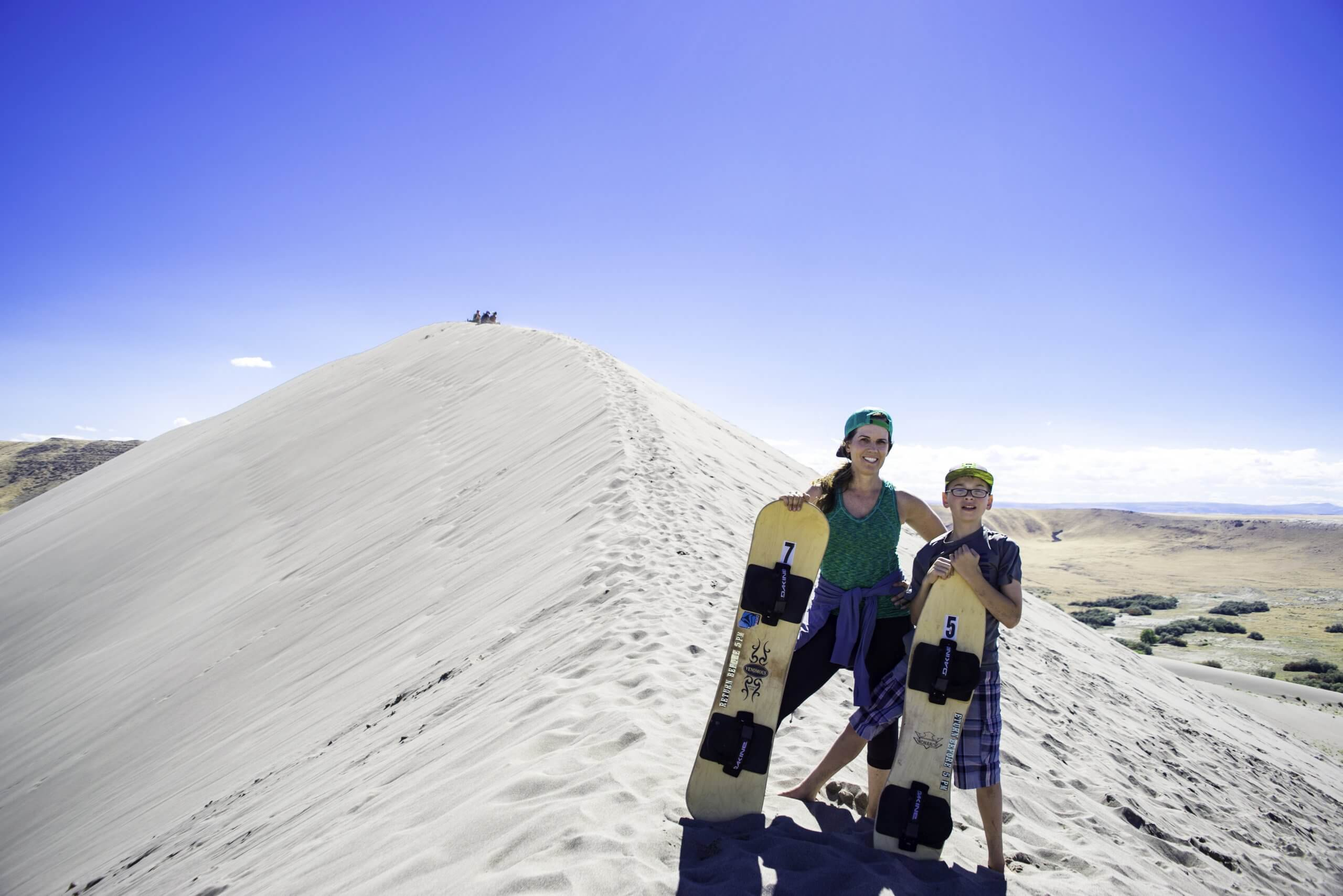 It was quite a workout hiking up the sand dunes, but so much fun sandboarding down them!