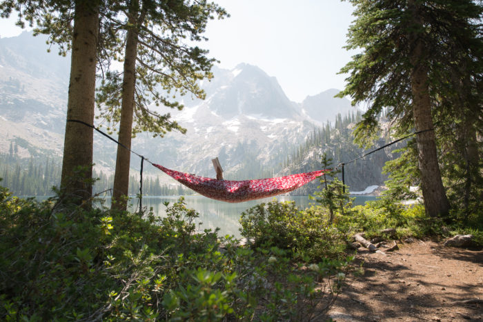 person in hammock in the mountains