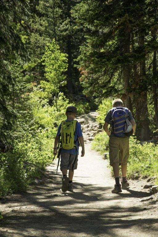 boys hiking on a mountain trail
