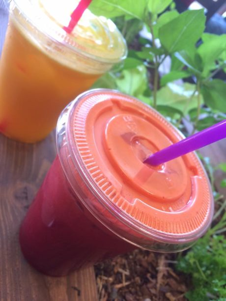 two juices in plastic cups