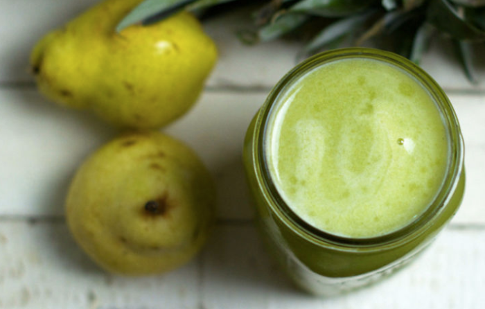 green juice next to pears