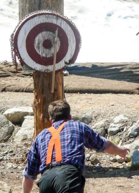 man throwing axe