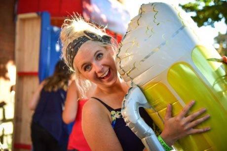 woman holding beer balloon