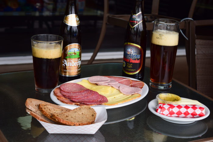 meat and cheese plate with beers