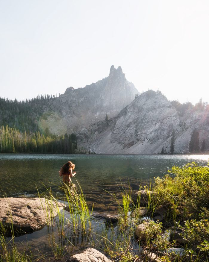 woman swimming in alpine lake
