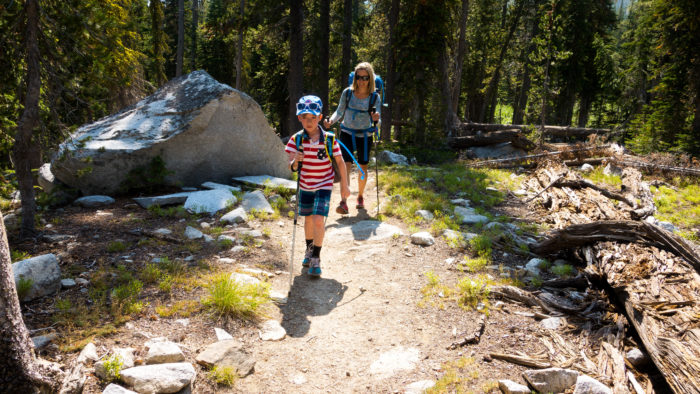 mom and son walking on mountain path