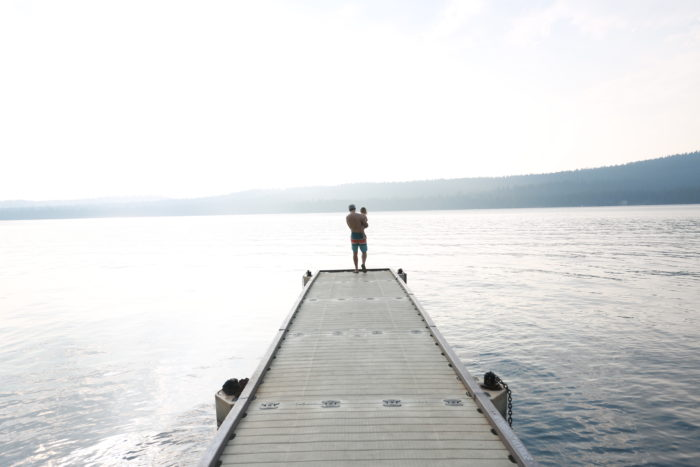 dad and child on dock