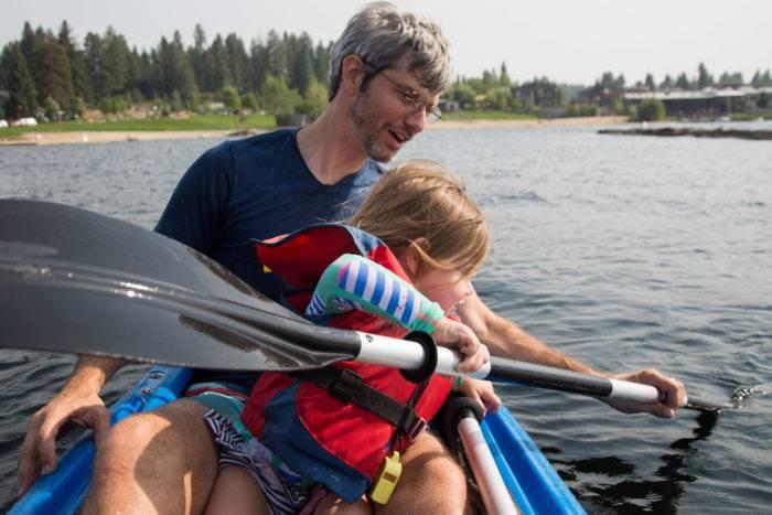 dad and daughter paddling kayak