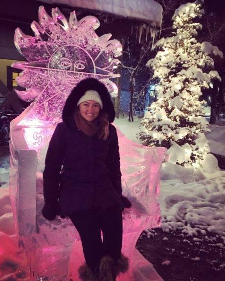 woman sitting on ice sculpture