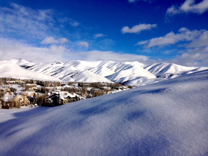 snowy mountains with town in the valley