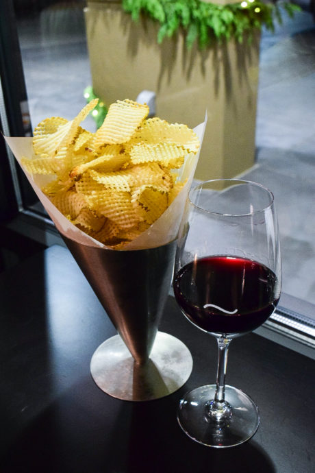 potato chips with a glass of wine