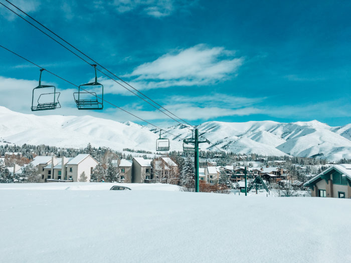 snowy mountains with chairlift in foreground