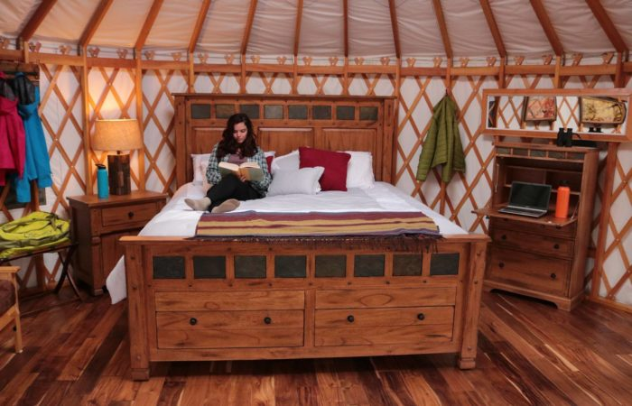 woman sitting on bed in yurt