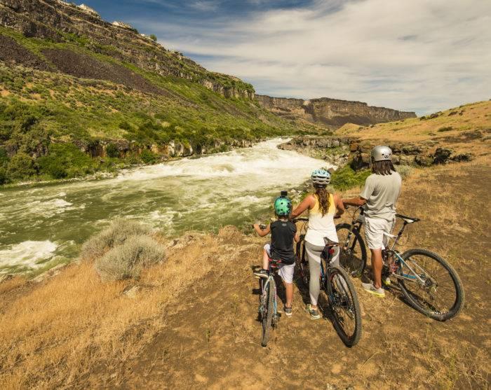 mountain bikers near waterfall