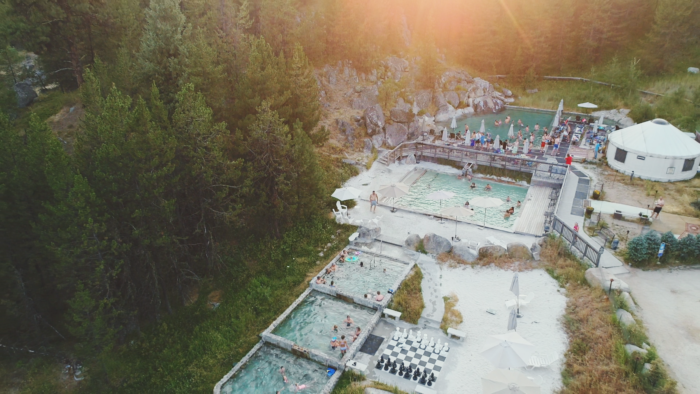 A scenic view of Gold Fork Hot Springs in the summer.