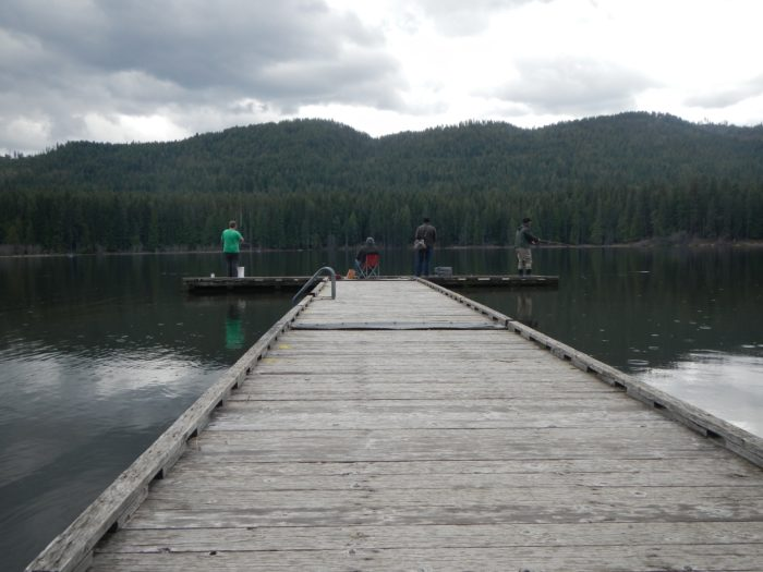 people fishing off a dock