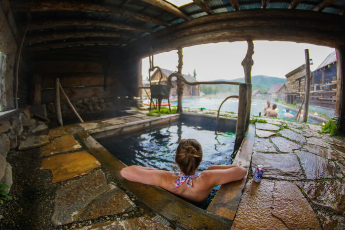 woman soaking in hot spring