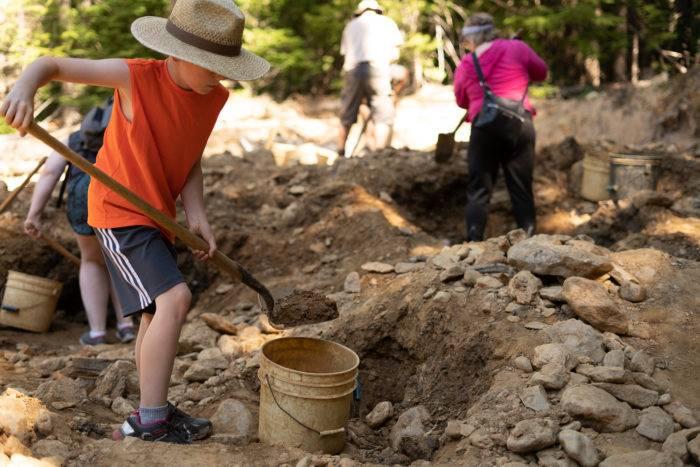 kid digging dirt