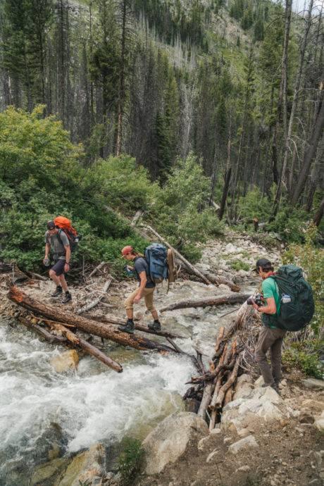 hikers crossing river