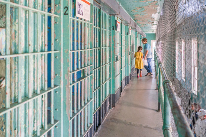 kids walking in historical prison