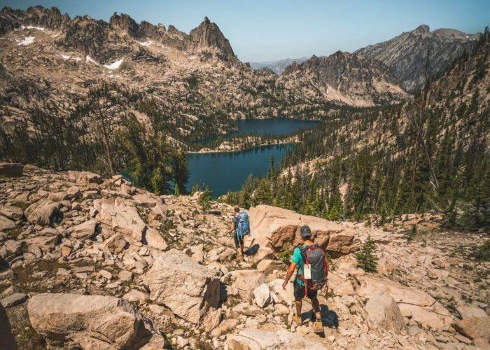 people hiking alpine lake.