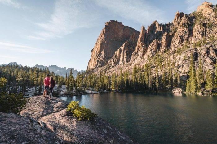 hikers at alpine lake