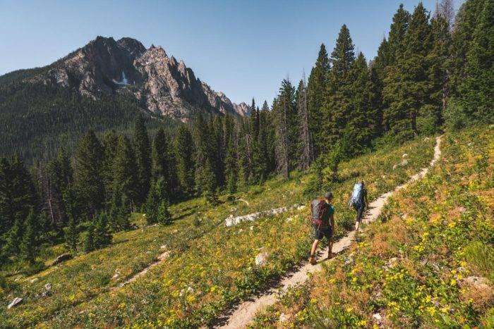 people hiking mountain ridge