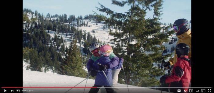 A family skiing at Tamarack Resort.