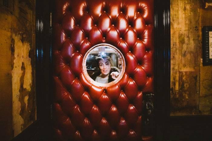 woman looking through door