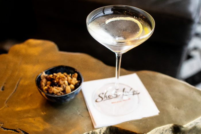 cocktail and bowl of nuts