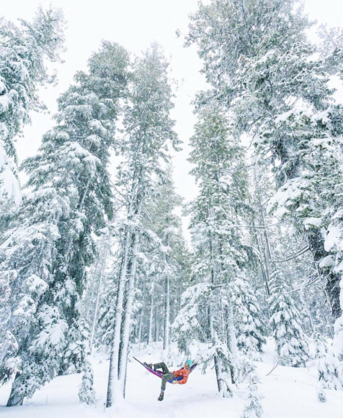 A man in a hammock in the snow.