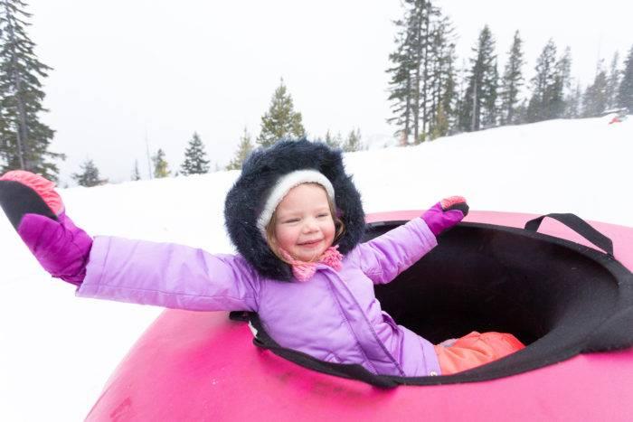toddler in snow tube