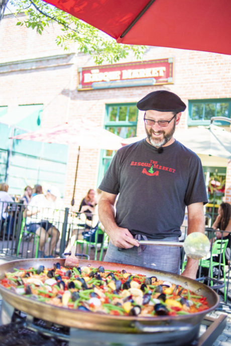 man cooking paella