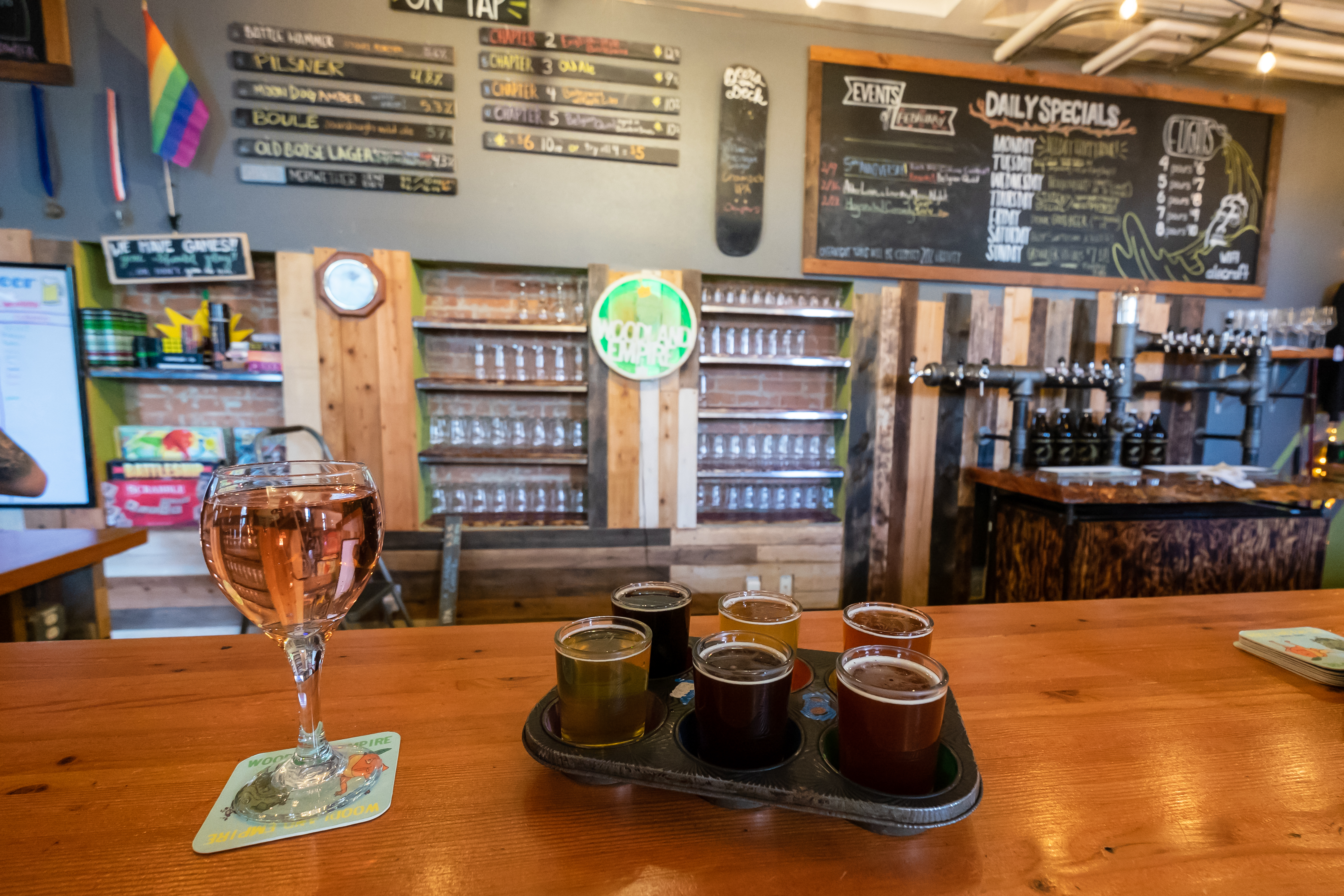 Test out a beer flight at Woodland Empire. Photo Credit: Traveling Newlyweds.