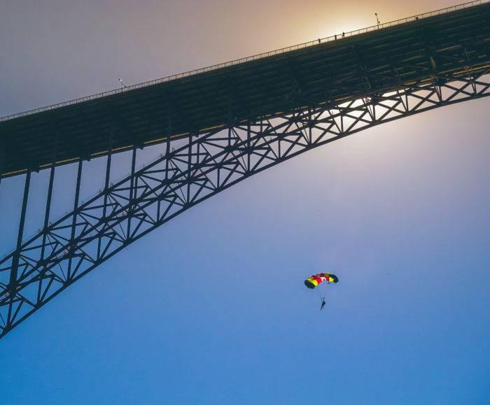 bridge with man on parachute