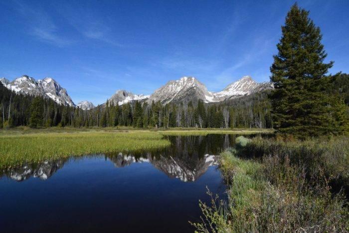 mountain reflection in still lake